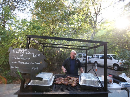 Mike Adams, owner of Adam's Rib Smoke House, serves