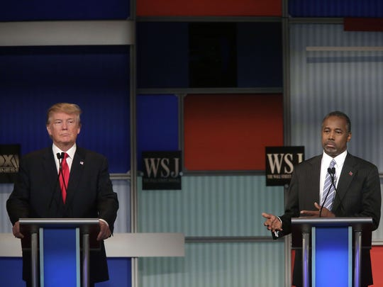 Republican presidential candidates Donald Trump (L) and Ben Carson (R) participate in  the Republican Presidential Debate hosted by Fox Business and The Wall Street Journal November 10, 2015 in Milwaukee, Wisconsin.