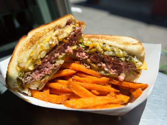 Wannabe Farms Food Truck's own Green Chile Patty Melt on Texas Toast served with sweet potato fries on July 7, 2016. Owner and chef Gabe Payan prepares his dishes using local ingredients from his farm or by other New Mexico locals.