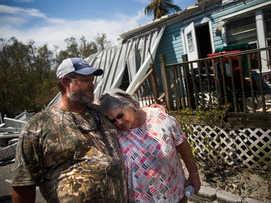 "Robby Daffin consoles his mother, Nancy Daffin, as she returns to her destroyed home on Plantation Island for the first time on Wednesday, September 13, 2017 in Everglades City, three days after Hurricane Irma. ""I care about her more than anything,"" said Daffin. During the eye of Hurricane Irma, Daffin drove to his mother's house to check on it. While leaving Plantation Island, Daffin became trapped by rapid flood waters and feared for his life. After finally contacting his son on Snapchat, he was rescued from the bridge."