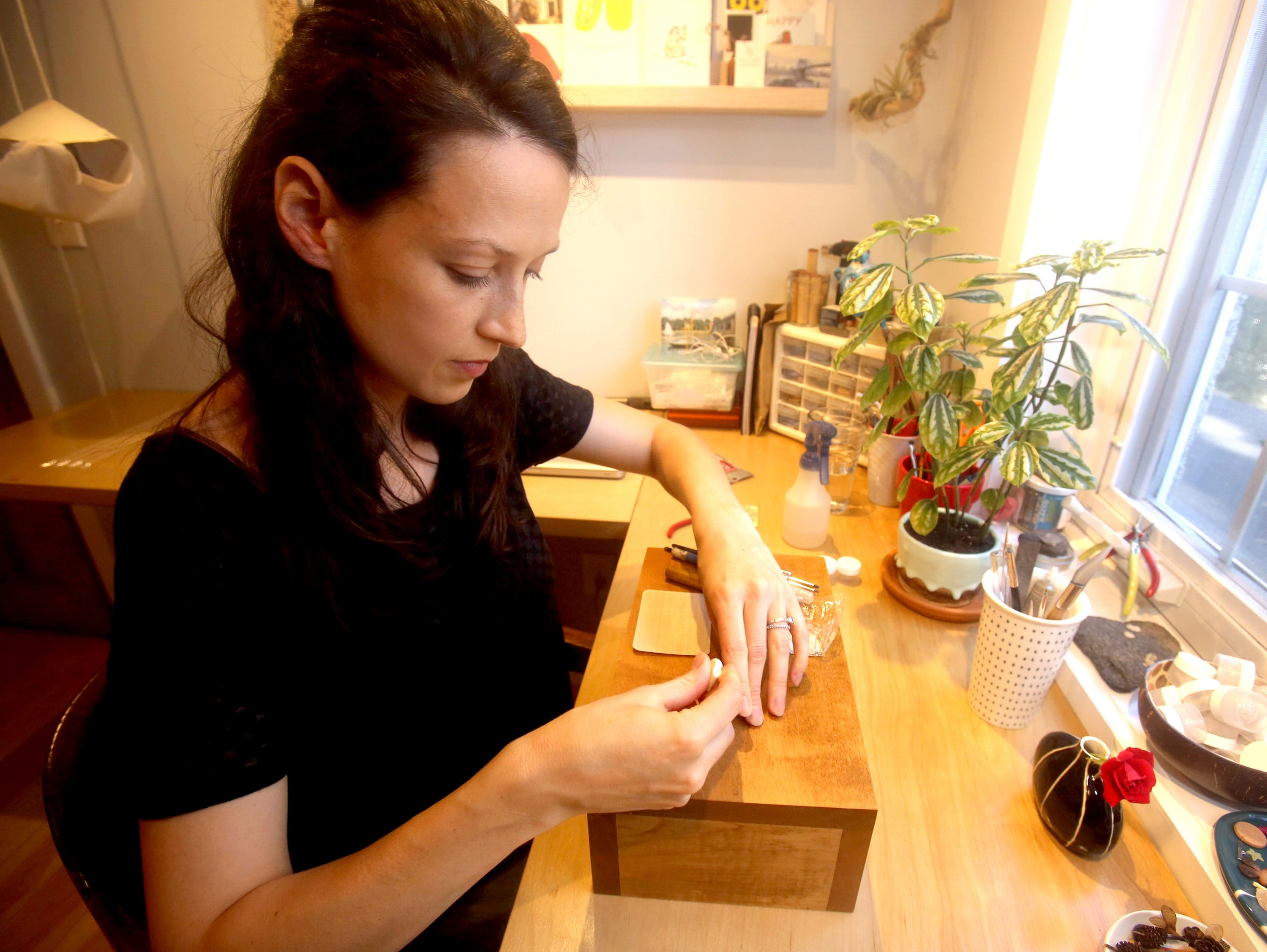 Jewelry maker Caitlin McNamara works in her home studio