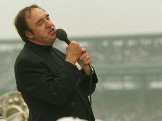 Entertainer Jim Nabors sings, 'Back Home Again in Indiana'