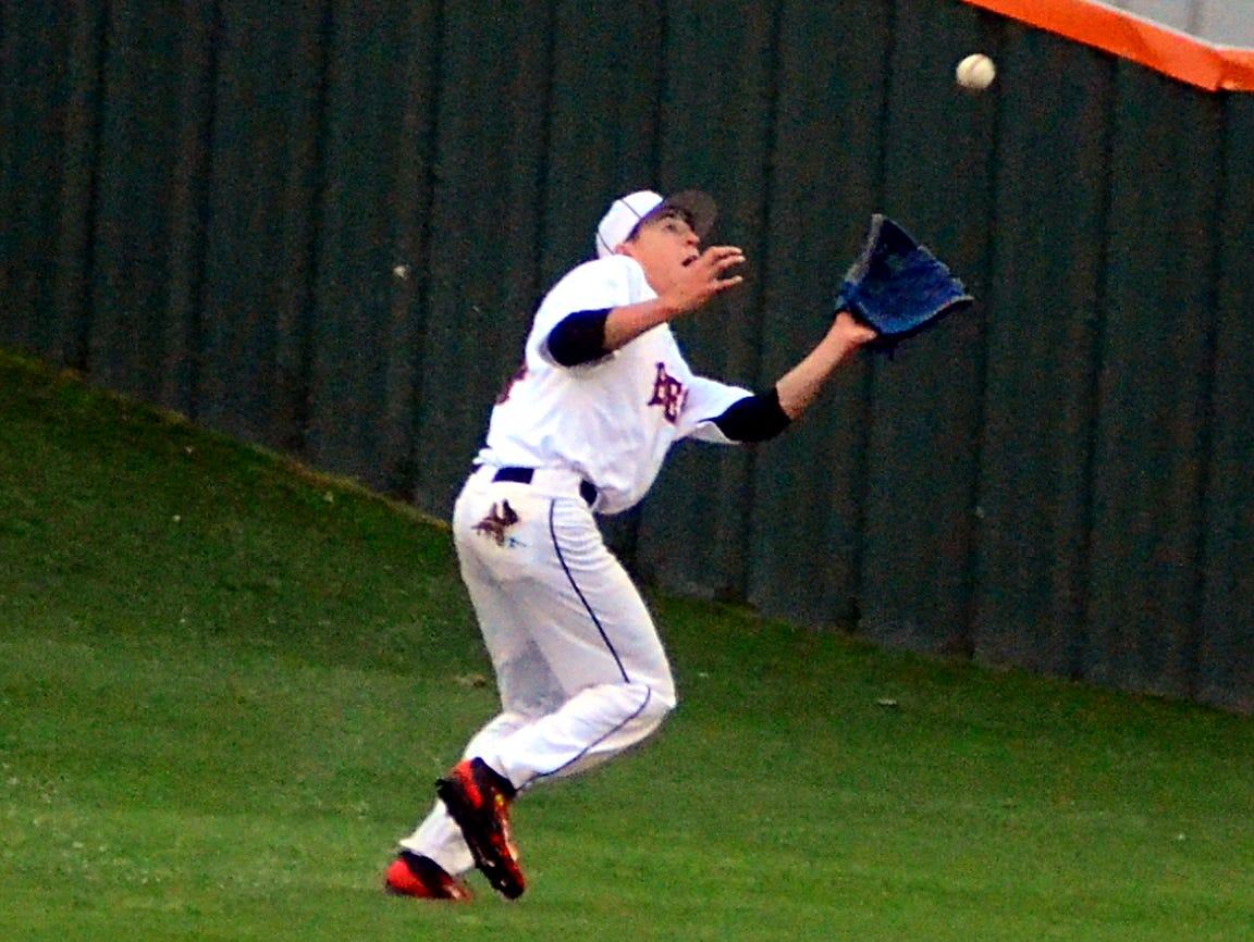 Beech High senior centerfielder Isaac Robertson catches a fly ball during first-inning action.