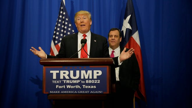 Republican presidential candidate Donald Trump, left, speaks as New Jersey Gov. Chris Christie looks on during a new conference before a rally in Fort Worth, Texas, on Friday.