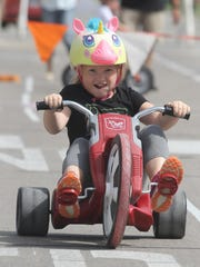 Above: Eveah Money, 8, races on a big wheel. The Indianola Parks and Recreation Department sponsored the annual Bike Fest on the Indianola Square on June 17.