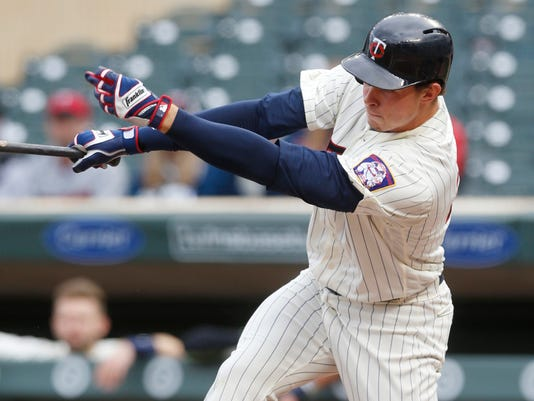 Minnesota Twins' Max Kepler follows through with an RBI single off Colorado Rockies pitcher Tyler Chatwood during the first inning of the second game of a baseball doubleheader, Thursday, May 18, 2017, in Minneapolis. (AP Photo/Jim Mone)