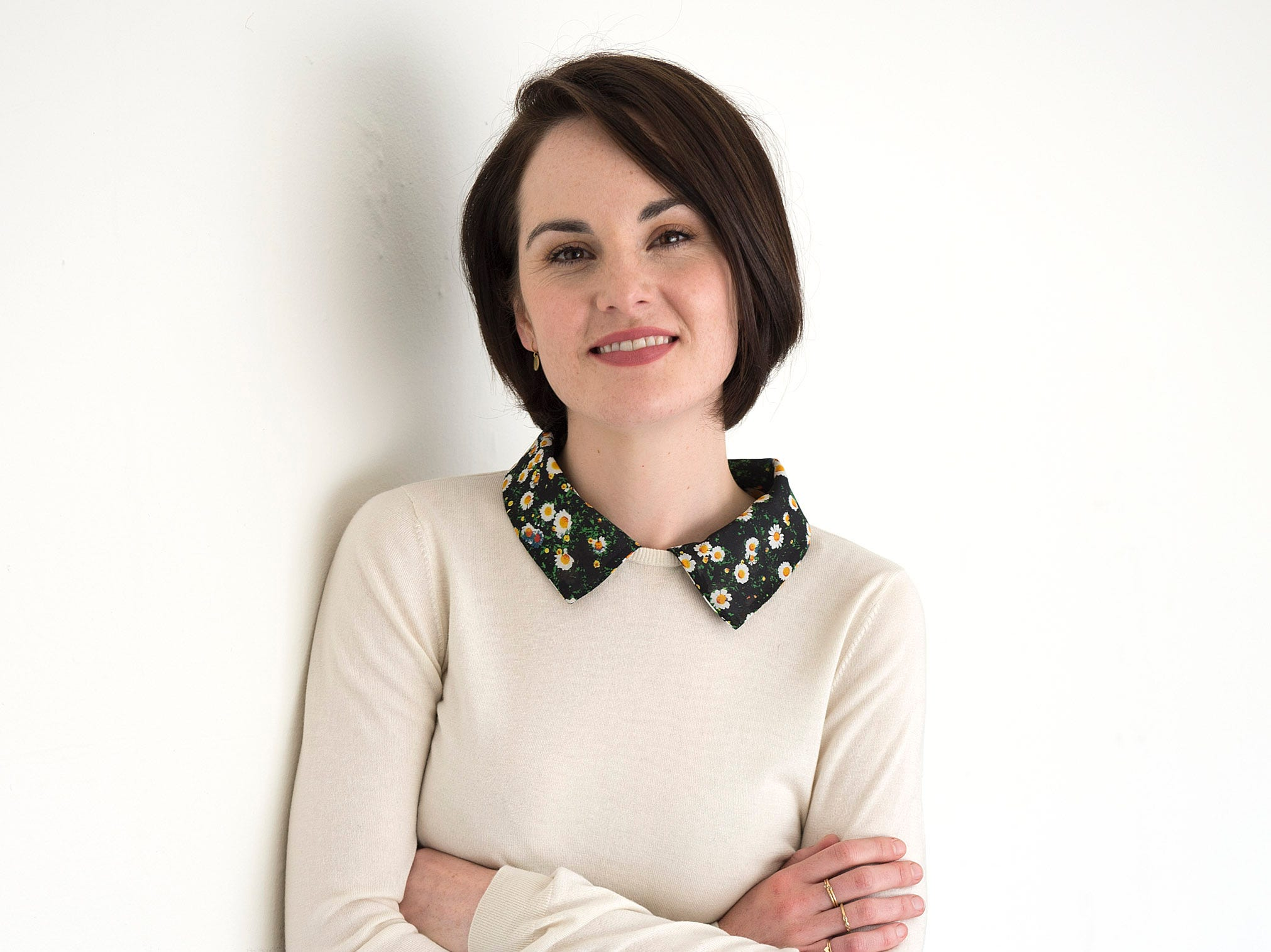 'Downton Abbey' actress Michelle Dockery looks prim and proper, like her on-screen alter ego in a collared sweater and flouncy skirt during a portrait session in Beverly Hills on Aug. 6.