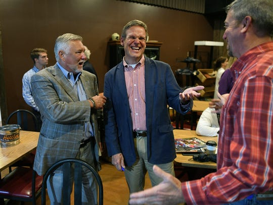 Bill Lee jokes with supporters after a town hall meeting