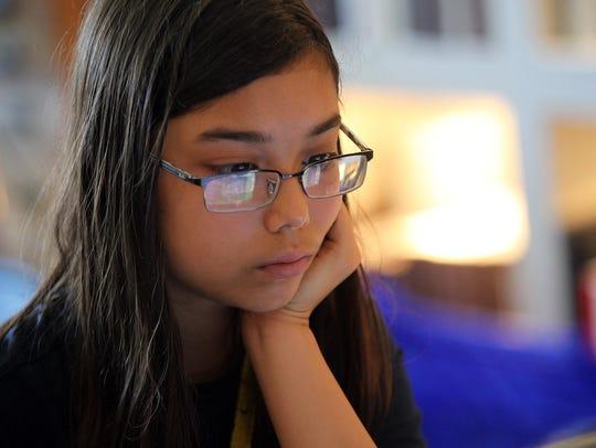 Ananya Albrecht-Buehler, 12, of Iowa City works on