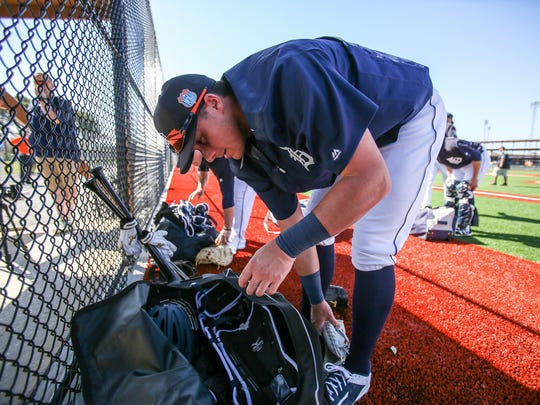 Tiger catcher James McCann gets his glove out of his bag, during Detroit Tigers spring training at Joker Marchant stadium in Lakeland, Fla. on Friday, Feb. 19, 2016.
