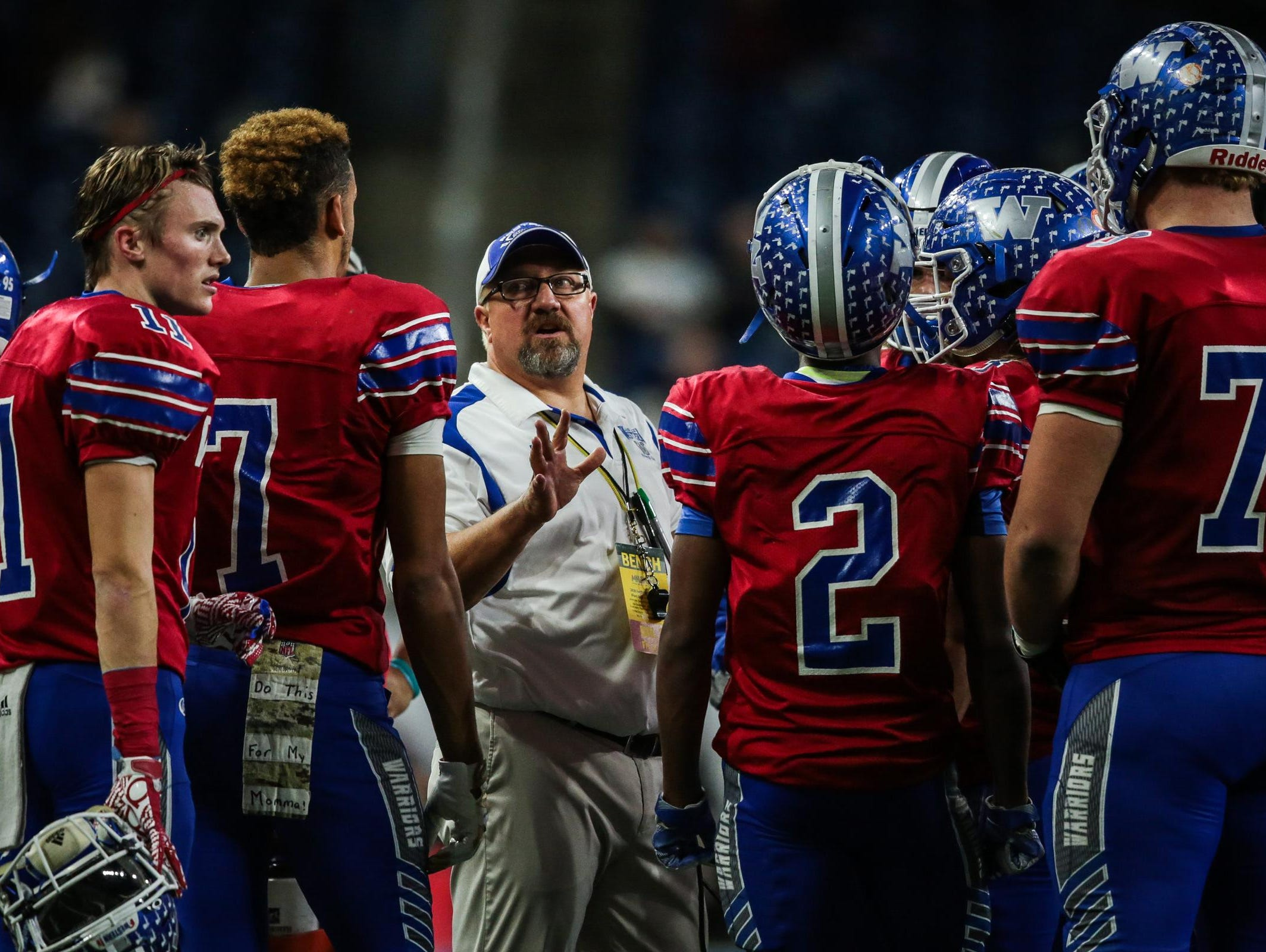 Walled Lake Western head coach Mike Zdebski talks to his team during the Division 2 state final Friday against Detroit King. Zdebski's late father, Frank, was a Marine.