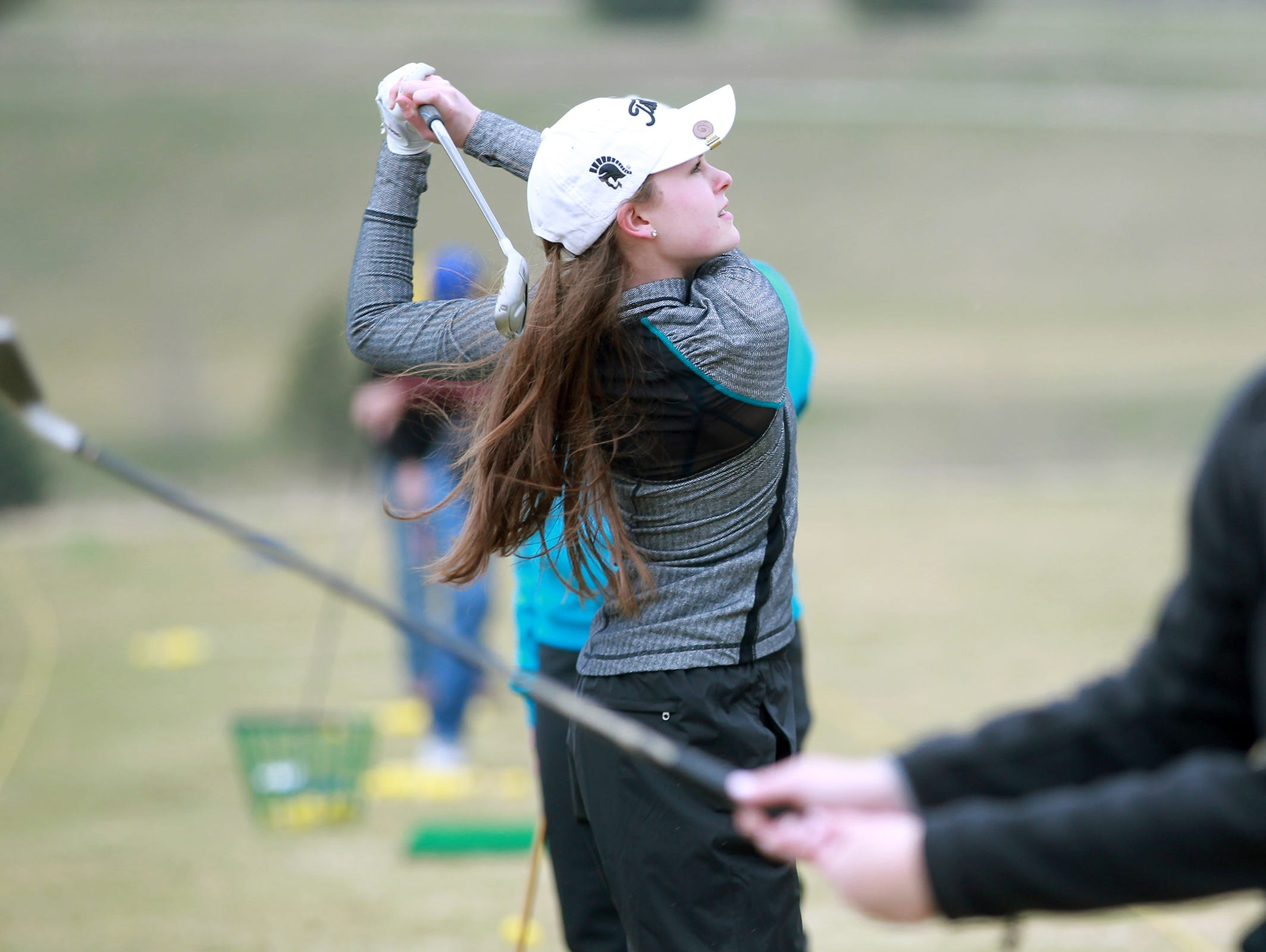 West High's Avery Kout practices with teammates at the Brown Deer Golf Club in Coralville on Monday afternoon.