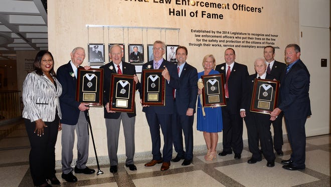Inductees honored at Florida's inaugural Law Enforcement Officers' Hall of Fame Induction Ceremony on Sunday, May 01, 2016. Bill sponsor, Daphne Campbell, left, and Inductee Willis Booth, and Inductee Thomas Hurlburt Jr., and Inductee James Medley, and FDLE Commissioner Rick Swearingen, and wife of Larry Campbell, Machelle Campbell, and son of Larry Campbell, Jack Campbell, and Inductee Leonidas Thalassites, and brother of Larry Campbell, David Ferrell, and nominator of Leonidas Thalassites, Jim Diamond.