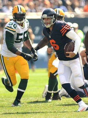 Chicago Bears quarterback Jay Cutler (9) scrambles for a long gain against the Green Bay Packers at Soldier Field September 28, 2014.  Jim Matthews/Press-Gazette Media/@jmatthe79