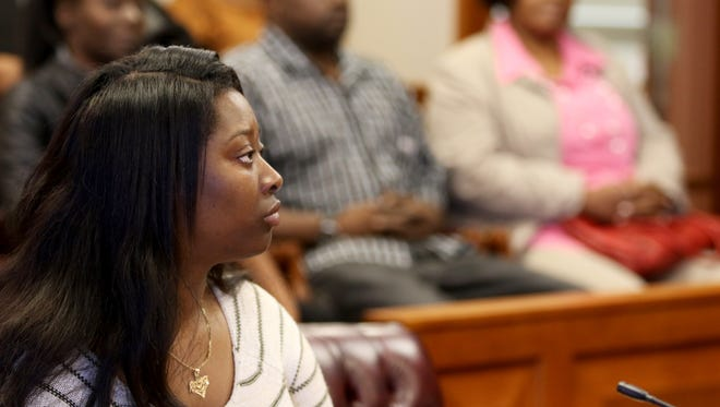 """Raegan Brooks, Sam DuBose's 18-year-old daughter, listens to closing arguments during  Hamilton County probate court where Judge Ralph """"Ted"""" Winkler will decide how the settlement of a where $4.85 million a wrongful death settlement will be divided among family members. Photo shot Wednesday April 20, 2016."""