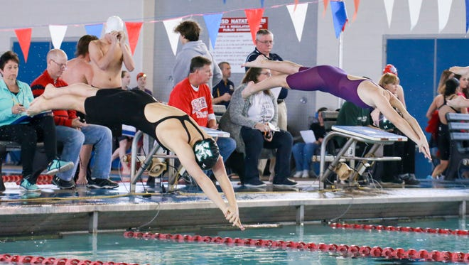 King teammates Elle Boyd, from left, and Claire Croman dive in unison in the girls' 200 yard freestyle at the District 30-5A Swimming and Diving Championships at the CCISD Natatorium on Saturday, January 28, 2017.