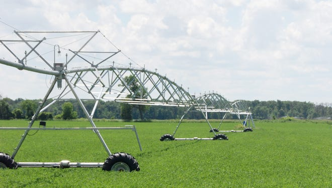 A center pivot irrigation rig for farm fields in Portage County.