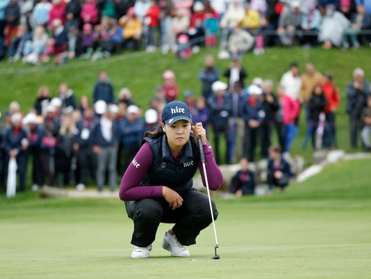 In Gee Chun, of South Korea, studies the 18th hole during the final round of the Evian Championship women's golf tournament in Evian, eastern France, Sunday, Sept. 18, 2016. (AP Photo/Laurent Cipriani)