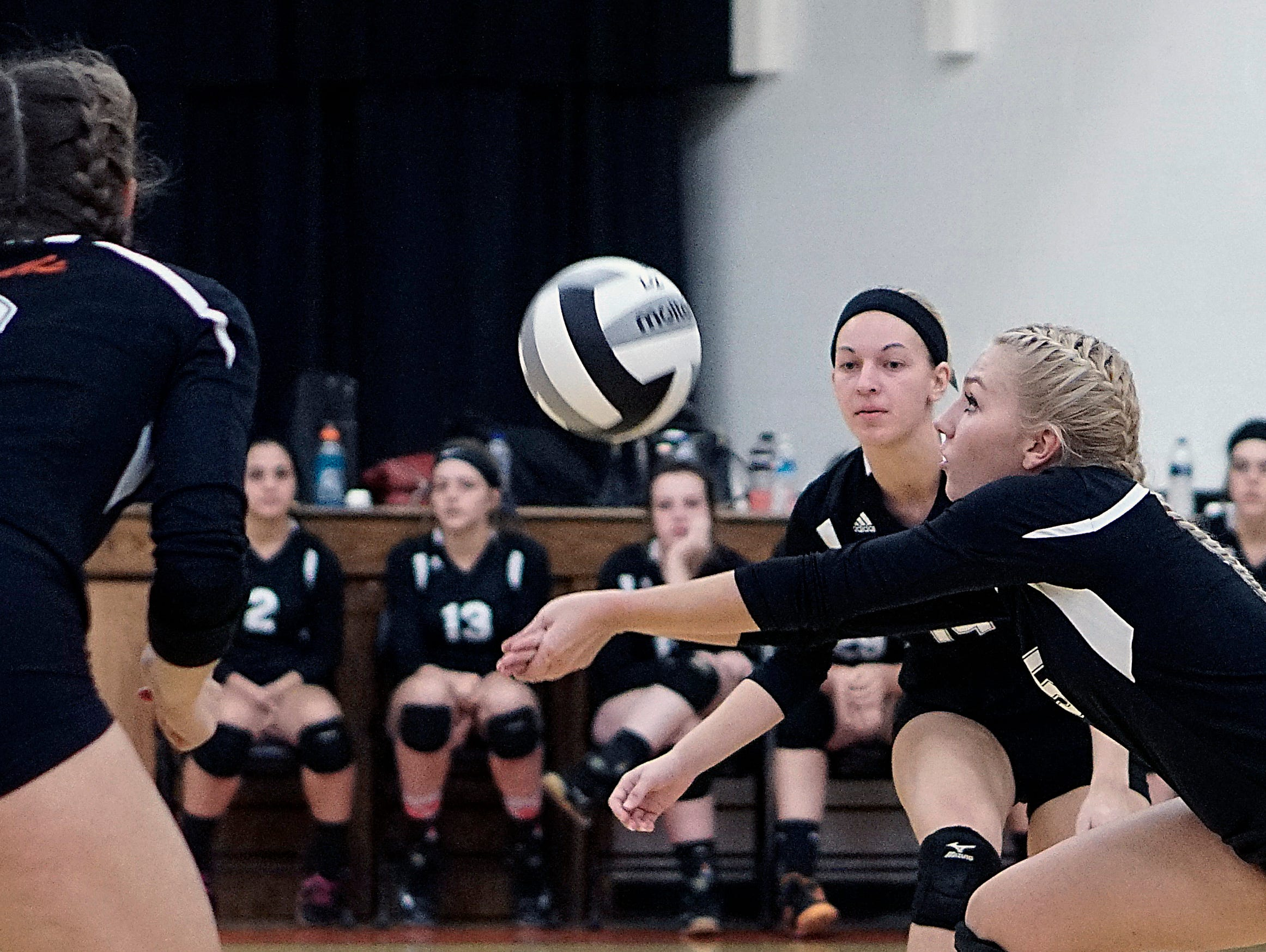 Lucas' Courtney Harris goes for a dig during their game against Mansfield Christian.