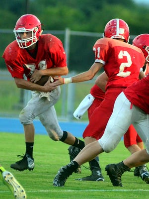 Senior Corey Gardner receives a handoff during a recent scrimmage. Gardner should see time at tailback for the Eagles' offense.