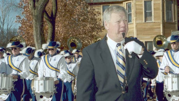 Longtime band director Jim McKinney marches the Pride