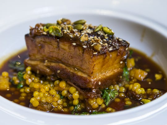 Pork belly with saffron fresola and dried fruits and pepitos, at Prado at Omni Montelucia Scottsdale.