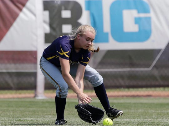 Tomahawk's Megan Marcks (17) fields the ball against Poynette, Saturday June 9, 2018. The Tomahawk Hatchets competed with the Poynette Pumas in the WIAA state championship game at Goodman Diamond in Madison, Wis.
