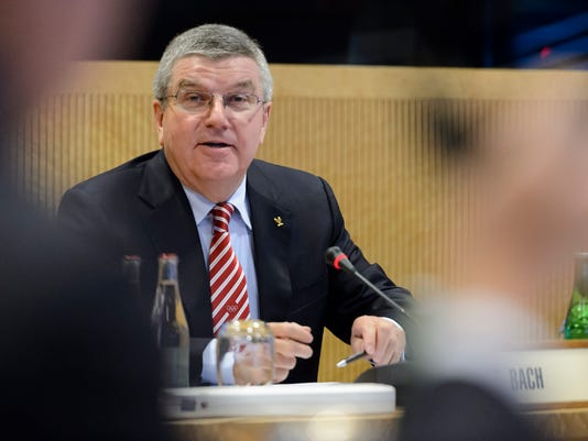 International Olympic Committee, IOC, president German Thomas Bach speaks during the opening of an executive board meeting of the IOC at their headquarters in Lausanne, Switzerland, Tuesday, Dec. 8, 2015. (Laurent Gillieron/Keystone via AP)