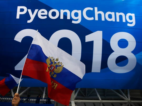 A fan of the Olympic athletes from Russia waves a flag before the men's gold medal hockey game against Germany at the 2018 Winter Olympics, Sunday, Feb. 25, 2018, in Gangneung, South Korea. (AP Photo/Jae C. Hong)