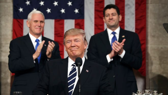 President Trump, flanked by Vice President Mike Pence and House Speaker Paul Ryan, delivered an address to a joint session of Congress on Feb. 28, 2017.