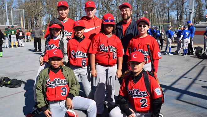Team Callen Construction poses for a photo during the South Vineland Little League Opening Day ceremonies.