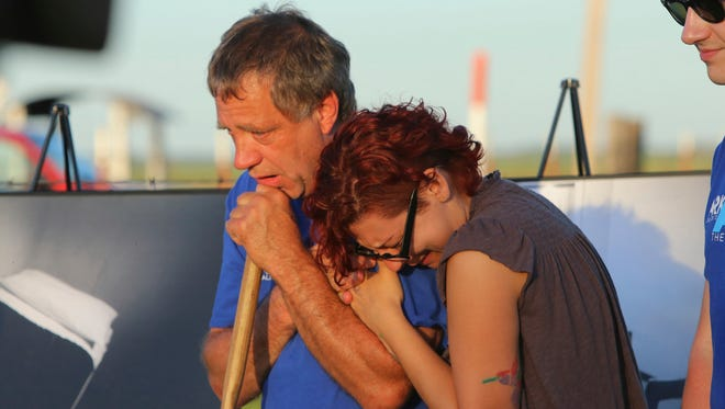 In this April 24, 2017 photo, anti-death penalty supporter Randy Gardner, left, embraces Gina Grimm, daughter of inmate Jack Jones, outside the Varner Unit near Varner, Ark. Jack Jones and Marcel Williams received lethal injections on the same gurney about three hours apart.