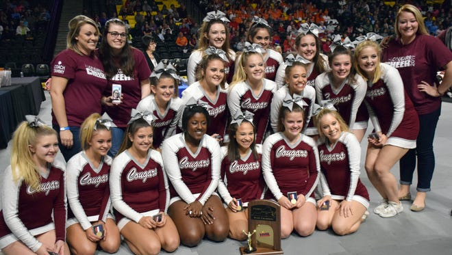 Stuarts Draft's competition cheer team poses with its medals and the first-place trophy after winning the Class 2 state title at the VHSL Cheer Championships on Saturday, Nov. 4, 2017, at the Siegel Center in Richmond, Va.