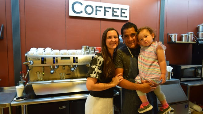 Lauren and Alex Flores, with daughter Felicity, have opened Bold Cup Coffee at the Avenue Viera.