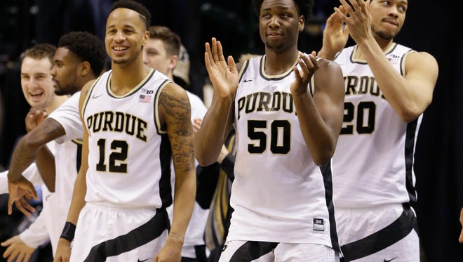 Purdue's Vince Edwards (12), Purdue's Caleb Swanigan (50) and Purdue's A.J. Hammons (20) celebrate during the second half of the win over Illinois in the Big Ten tournament quarterfinal Friday in Indianapolis.