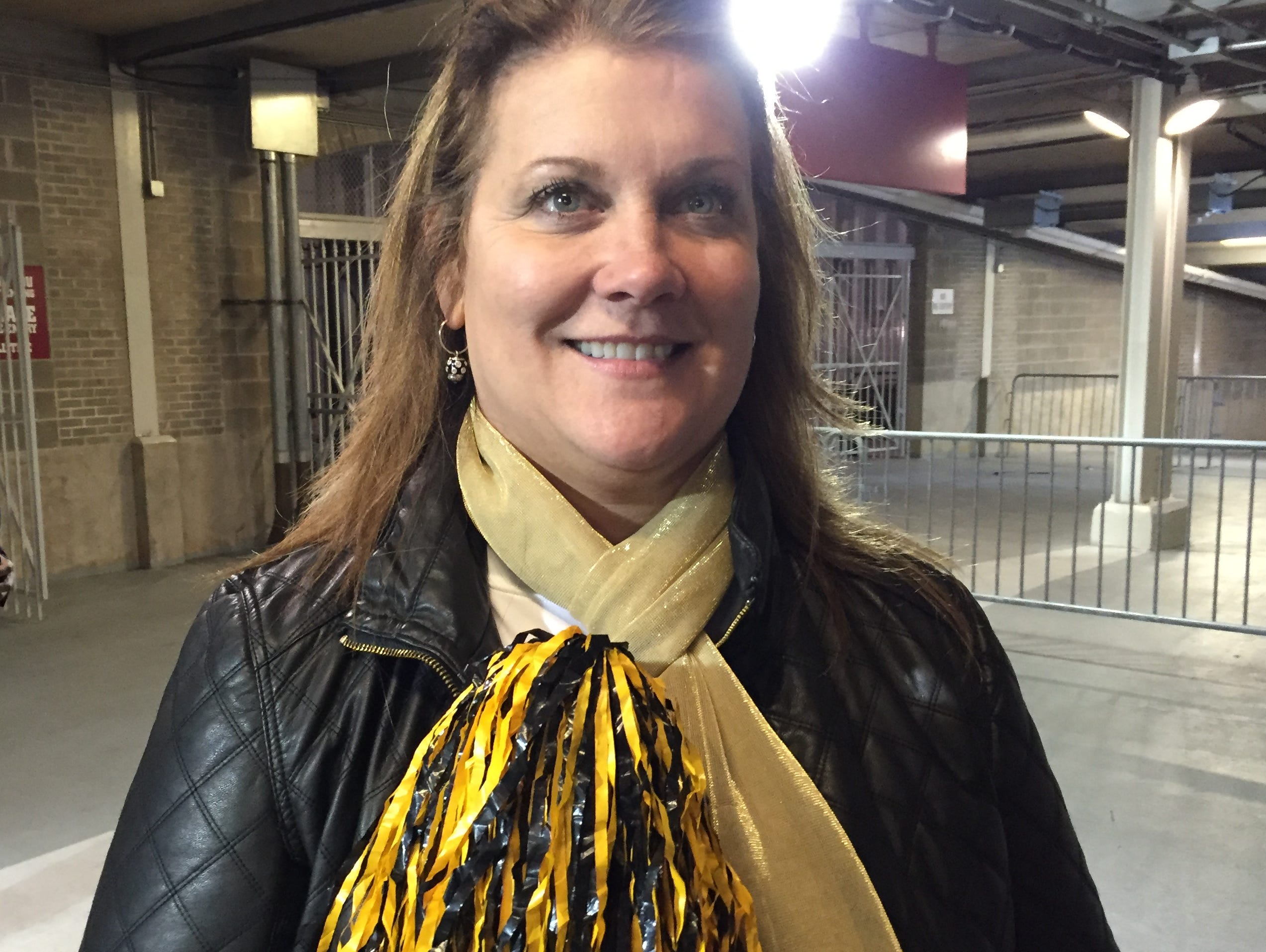 Troy women's basketball coach Chanda Rigby shows her support for Elba after Friday's 2A championship. Her son is the quarterback and her husband the coach of the Tigers.