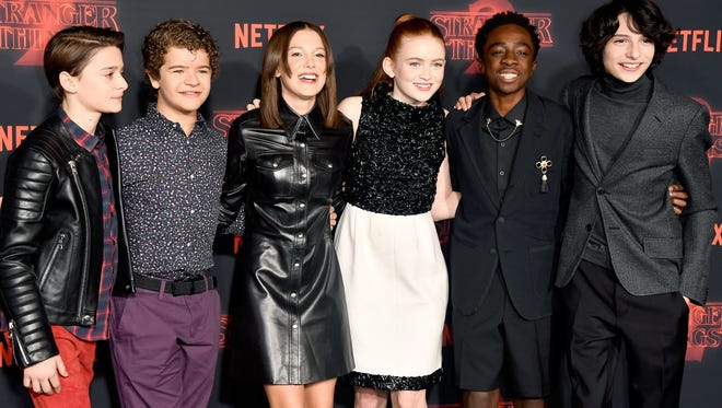 "(L-R) Noah Schnapp, Gaten Matarazzo, Millie Bobby Brown, Sadie Sink, Caleb McLaughlin, and Finn Wolfhard attend the premiere of Netflix's ""Stranger Things"" Season 2 at Regency Bruin Theatre on October 26, 2017 in Los Angeles, California."