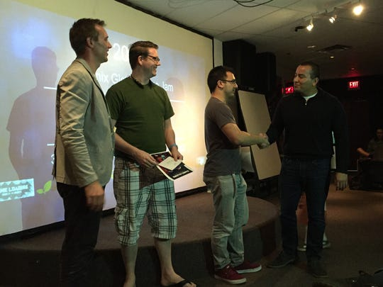 Ben Reichert (left) and Phoenix Vice Mayor Daniel Valenzuela (right), awarding prizes at the Phoenix Global Game Jam at the University of Advancing Technology in Tempe, Arizona.