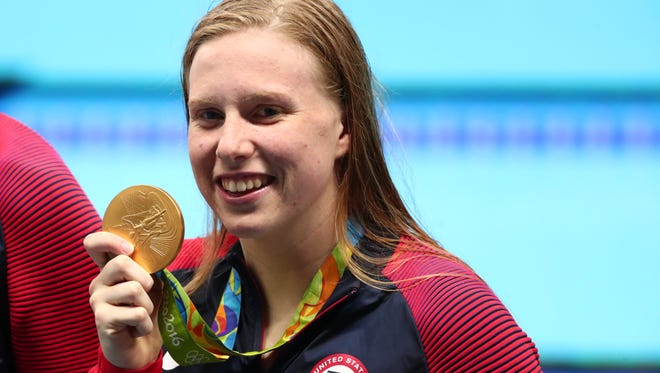 Lilly King (USA) with her gold medal after the women's 4x100 medley relay final in the Rio 2016 Summer Olympic Games.