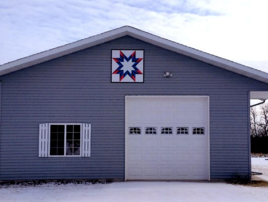 A barn quilt on a shed at the Marv and Ileen Schmitt