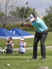J.B. Holmes tees off Tuesday during the Pete and Alice
