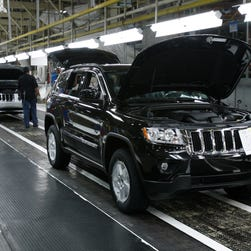 In this 2010 file photo, a Jeep Grand Cherokee rolls off the assembly line at the Chrysler Jefferson North Assembly Plant in Detroit