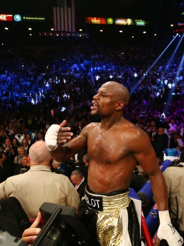 Floyd Mayweather reacts after his welterweight championship