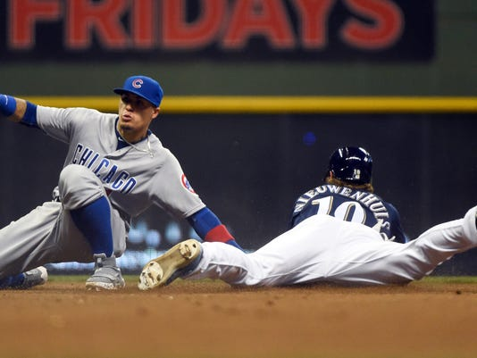 Chicago Cubs second baseman Javier Baez, left, tags out Milwaukee Brewers' Kirk Nieuwenhuis who was trying to steal second during the sixth inning of a baseball game Saturday, July 23, 2016, in Milwaukee. (AP Photo/Benny Sieu)