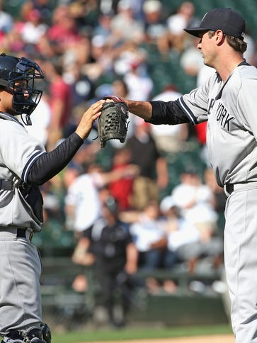 Pitcher Andrew Miller of the Yankees is congratulated