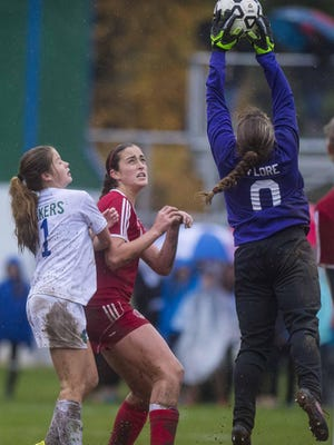 CVU goalie Michaela Flore, right, pulls down a ball in front of Colchester's Madison Finelli, left, and Lia Gagliuso in Colchester on Wednesday afternoon.