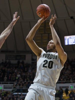 Boilermakers center A.J. Hammons (20) shoots the ball in the second half of the game against the Northwestern Wildcats at Mackey Arena.