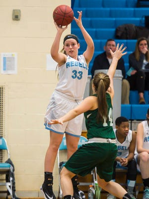 South Burlington's Emma MacDonough shoots over St. Johnsbury Academy's Allison Brink in South Burlington on Friday, January 6, 2017.
