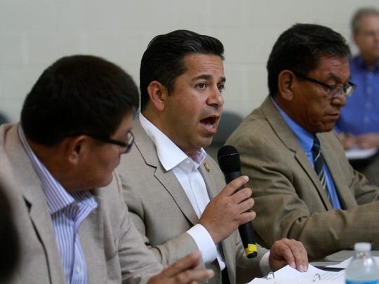 From left, Navajo Nation Council Speaker LoRenzo Bates, U.S. Rep. Ben Ray Lujan and Navajo Nation President Russell Begaye participate in a round table discussion on the Gold King Mine on Tuesday at the Sycamore Park Community Center in Farmington.