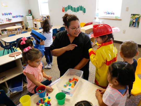 At center Early pre-kindergarten teacher Nishoni Johnson talks with her students, Thursday at A Gold Star Academy in Farmington in this 2016 file photo.